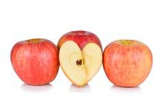 Pomme coupée et entière de gala Photographie stock libre de droits