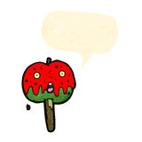 pomme de caramel de bande dessinée Images stock