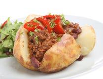 Pomme de terre cuite au four avec des s/poivron Images stock
