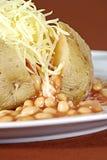 Pomme de terre en robe de chambre Photos stock