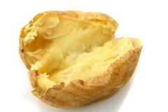 Pomme de terre en robe de chambre cuite au four avec du beurre sur le blanc Images libres de droits