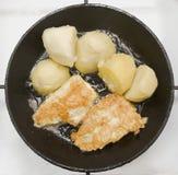 Pomme de terre et poissons Images libres de droits
