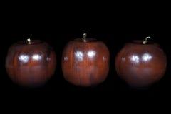 Pomme en bois Images libres de droits