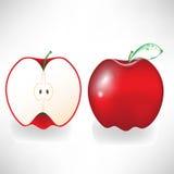 Pomme et demi rouges Photo stock