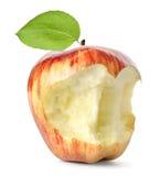 Pomme et lame rouges mangées   photographie stock