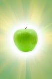 Pomme et soleil verts Image libre de droits
