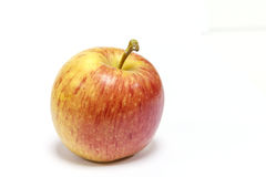 Pomme jaune rouge sur le blanc Photo stock