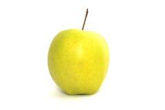 Pomme jaune sur un fond blanc Image libre de droits