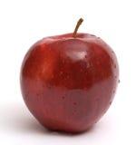 Pomme rouge au-dessus du fond blanc Images stock