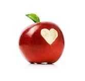 Pomme rouge avec le symbole de coeur Photos stock