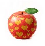 Pomme rouge d'isolement avec des coeurs Image stock