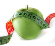 Pomme verte avec la bande de mesure Image libre de droits