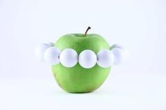 Pomme verte avec programmes blancs Photos libres de droits