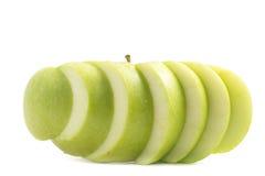 Pomme verte coupée en tranches photographie stock