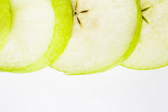 Pomme verte coupée en tranches photo stock