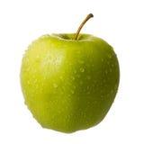 Pomme verte couverte de rosée images stock