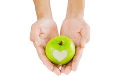 Pomme verte d'amour Photo stock