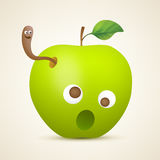 Pomme verte drôle avec le ver Photographie stock libre de droits