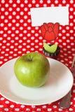 Pomme verte pour la pince à linge de déjeuner avec la carte Photos libres de droits