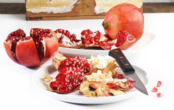Pommegrantes on plate. Ripe pomegrantes on white plate Stock Photography