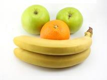 Pommes, bananes et orange. sourire Photos stock
