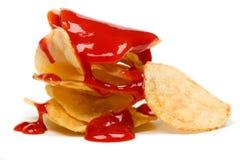 Pommes chips avec le ketchup images libres de droits