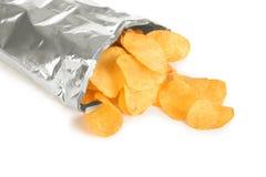 Pommes chips dans un paquet Photos stock