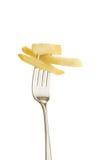 Pommes chips sur une fourchette photo stock