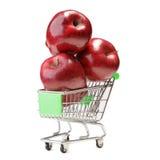 Pommes dans le caddie sur le blanc Photo libre de droits