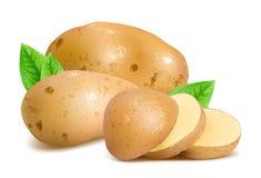 Pommes de terre avec des tranches et des feuilles Image stock