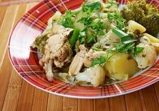Pommes de terre cuites par Français avec le poulet Photos stock