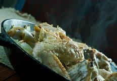 Pommes de terre cuites par Français avec le poulet Image stock