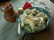 Pommes de terre cuites par Français avec le poulet Photo libre de droits