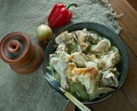 Pommes de terre cuites par Français avec le poulet Photographie stock