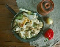 Pommes de terre cuites par Français avec le poulet Photos libres de droits