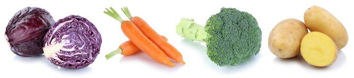 Pommes de terre de légume frais de carottes de légumes d'isolement dans une rangée Images libres de droits