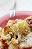 Pommes de terre de rôti avec des poissons Photos libres de droits