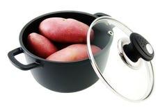 Pommes de terre et carter antiadhésif photos libres de droits