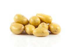 Pommes de terre fraîches sur un blanc Photographie stock libre de droits