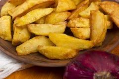 Pommes de terre frites en saindoux Photographie stock libre de droits