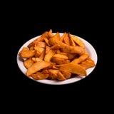 Pommes de terre frites sur le noir Photo libre de droits