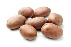 Pommes de terre rouges d'isolement sur le blanc Image libre de droits