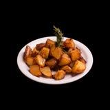 Pommes de terre soutenues sur le noir Image libre de droits