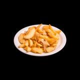 Pommes de terre soutenues sur le noir Photographie stock