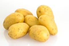 Pommes de terre sur le fond blanc Photographie stock libre de droits