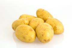 Pommes de terre sur le fond blanc Photographie stock