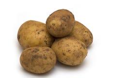 Pommes de terre sur le fond blanc Images stock