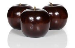 Pommes en bois rouges Photo stock