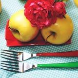 Pommes et fourchettes de couleur, place Photos libres de droits