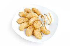 Pommes et glace cuites en friteuse photos stock